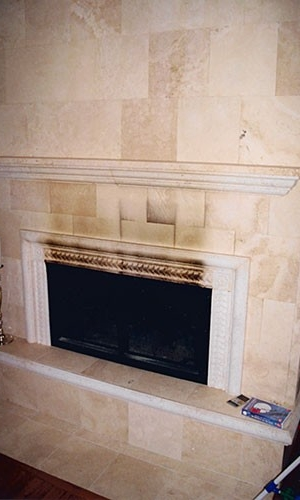 Removing smoke stains from a fireplace